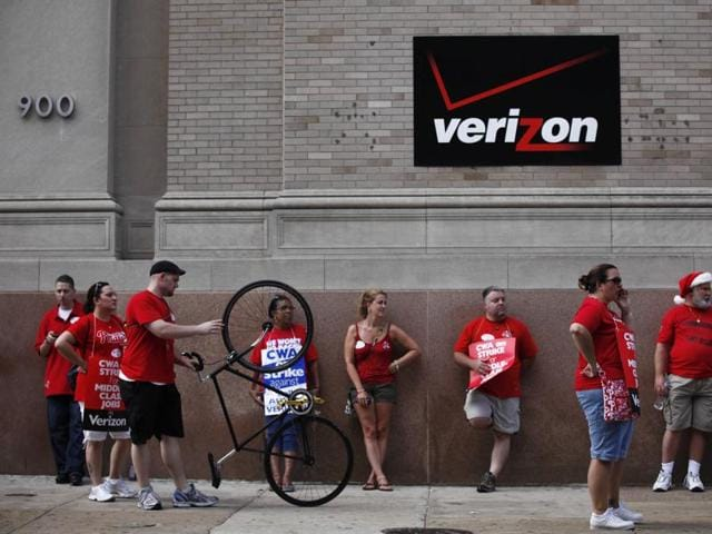 Verizon workers picket outside one of the company's central offices in Philadelphia.
