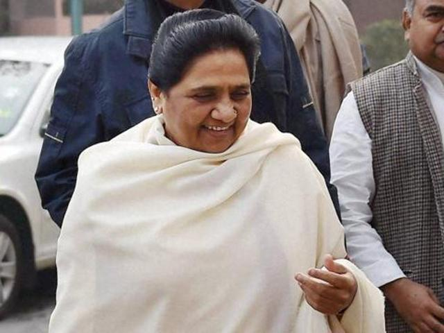 A file photo of BSP chief Mayawati with party leader S C Mishra during the winter session of Parliament in New Delhi.