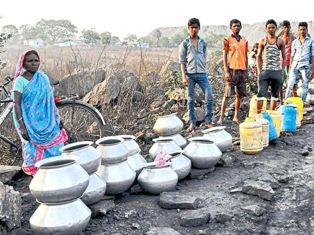 Residents of Bhera Kata Jharia wait for water tankers in Dhanbad on Wednesday.