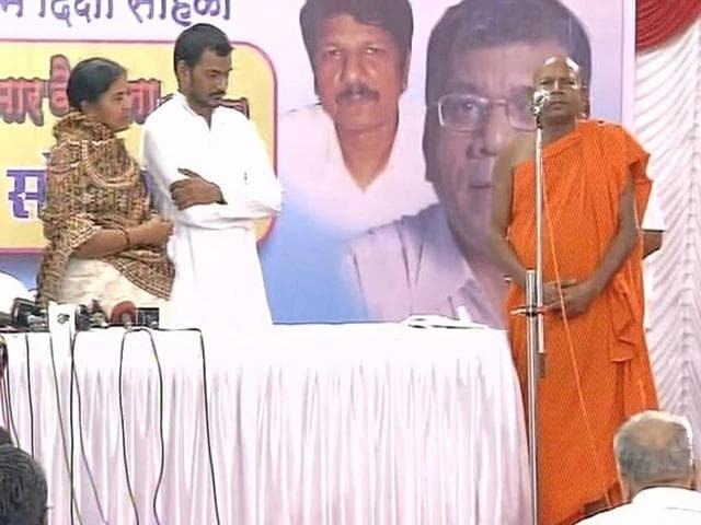 Dalit scholar Rohith Vemula's mother, Radhika, and brother, Raja, at the conversion ceremony in Mumbai on Thursday.