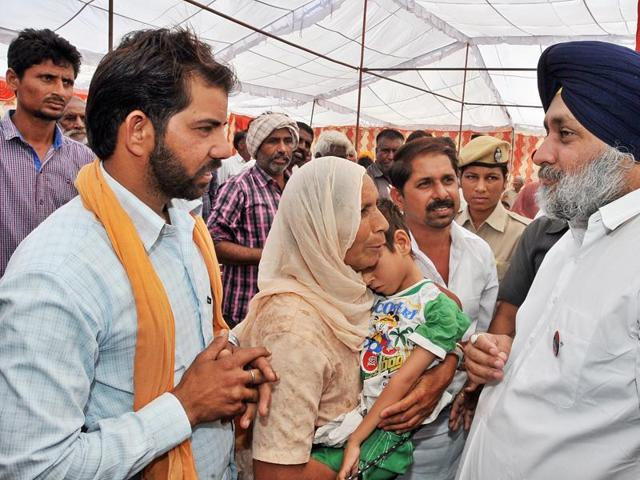 Deputy chief minister Sukhbir Singh Badal interacting with a villager during a 'Sangat Darshan' held at Jalalabad in Fazilka district on Thursday.
