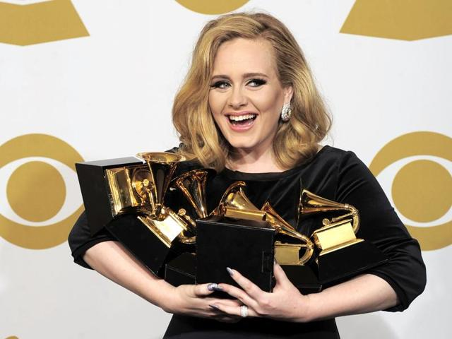 In this file photo, Adele poses backstage with her six awards at the 54th annual Grammy Awards. According to figures released Tuesday, Adele had the world's best-selling album last year, as the British singer's '25' sold 17.4 million copies.