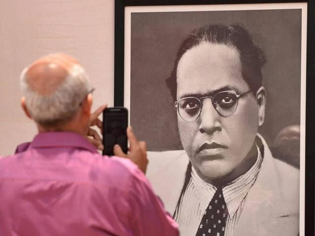 A man clicks a photo of BR Ambedkar's portrait outside 'Chaitya Bhoomi' on the occasion of his 125th birth anniversary in Mumbai on Thursday.