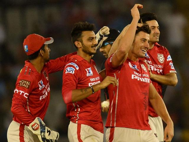 Kings XI Punjab cricketer Marcus Stoinis celebrates with teammates after dismissing Suresh Raina.