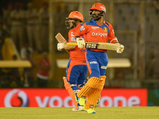 Gujarat Lions' Dinesh Karthik (front) and Aaron Finch take a single during the 2016 Indian Premier League (IPL) match against Kings XI Punjab at The Punjab Cricket Association Stadium in Mohali on April 11, 2016.