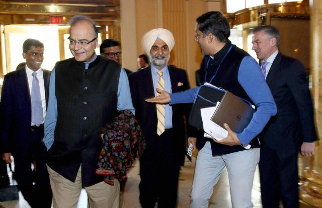 Finance Minister Arun Jaitley with Chief Economic Adviser (CEA) Arvind Subramanian and Taranjit Sandhu, Deputy Chief of Mission to Washington arrives his hotel in Washington DC on Wednesday.