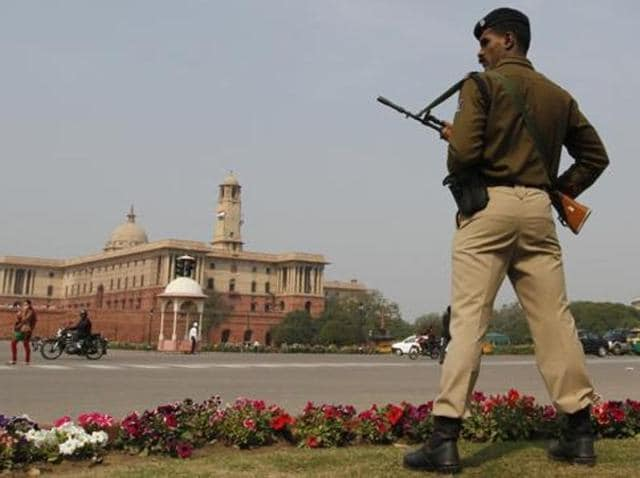 A CRPF jawan stands guard near the Parliament House.