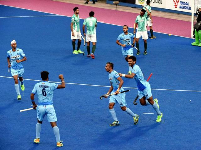 Indian Hockey team players celebrate a goal against Pakistan during the Sultan Azlan Shah Cup.