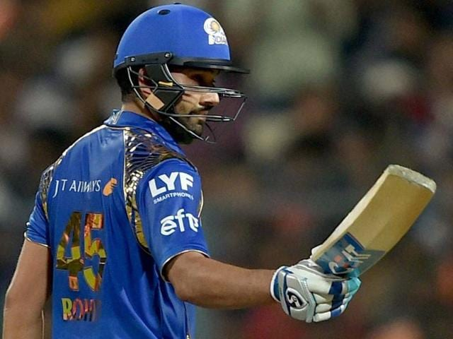 Mumbai Indian batsman Rohit Sharma acknowledges the cheers from the crowd after completing his half century.