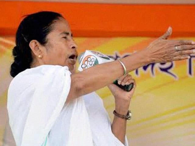 West Bengal chief minister and TMC chief Mamata Banerjee addresses an election campaign rally in support of party candidates in Nadia on Wednesday.