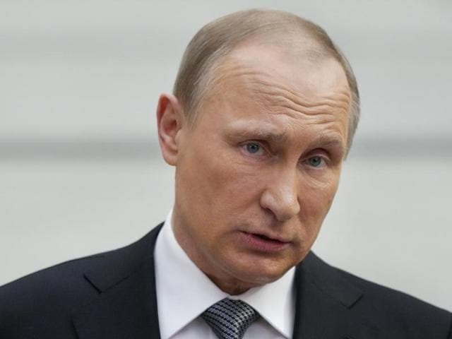 Russian President Vladimir Putin attends a live broadcast nationwide call-in in Moscow, Russia, April 14, 2016.