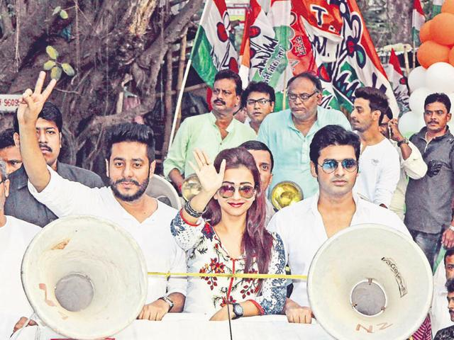 (From left) Tollywood filmmaker Raj Chakraborty along with actors Bony and Ankush take part in a TMC rally in West Bengal.