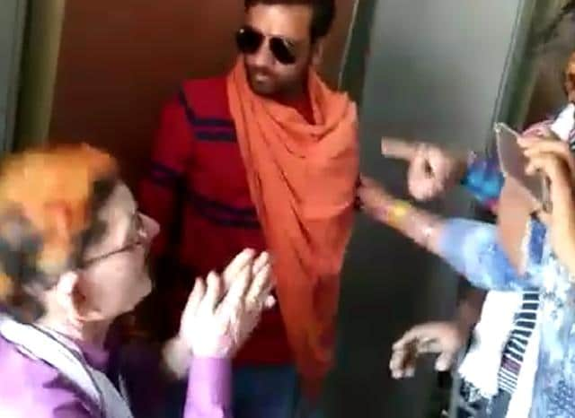 A video grab of the incident showing Narayan Khatri, the teacher, pleading before the saffron goons.