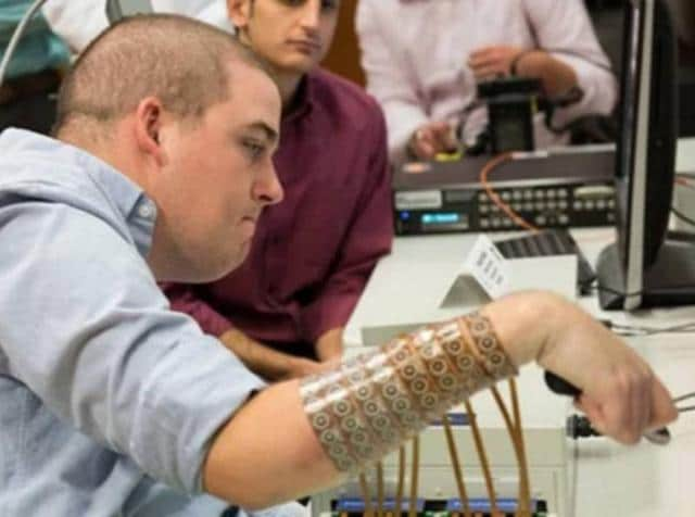 The device called NeuroLife is invented at Battelle -  the world's largest non-profit research and development organisation - along with neuroscientists from Ohio State University Wexner Medical Center