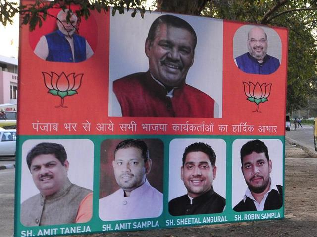 A BJP hoarding welcoming newly elected Punjab president Vijay Sampla on the dividing road of Sectors 24 and 37 in Chandigarh on Tuesday.