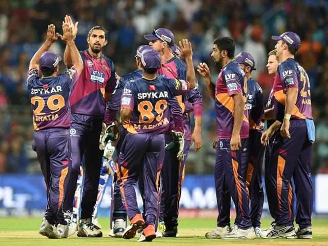 Rising Pune Supergiants' Ishant Sharma celebrates with teammates after taking the wicket.