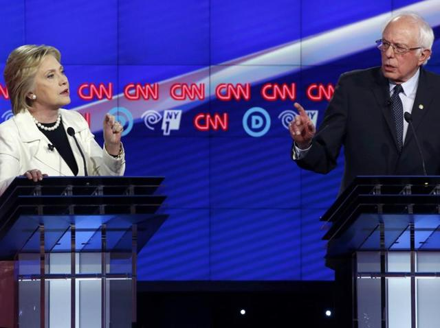 Democratic presidential candidates Hillary Clinton and senator Bernie Sanders speak during a debate at the Brooklyn Navy Yard in New York.