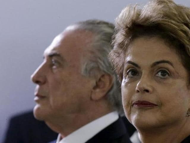 Brazil's President Dilma Rousseff  (R) risks being driven from office if the lower house votes in favour of an impeachment trial this Sunday.