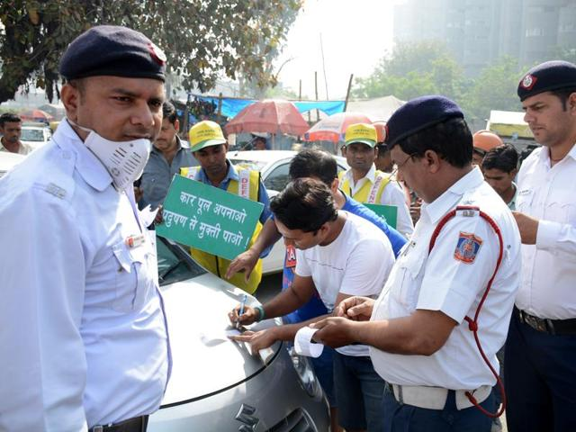 Commuters challaned by the traffic police at Delhi border.