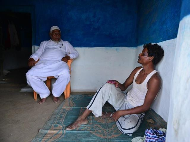 A Gond tribal with a contractor at village Ambadi in buffer area of Pench tiger reserve.