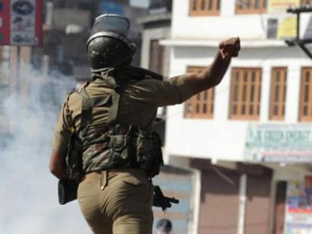 Police men patrol Srinagr following clashes between locals gunning for the army and the police on Wednesday.