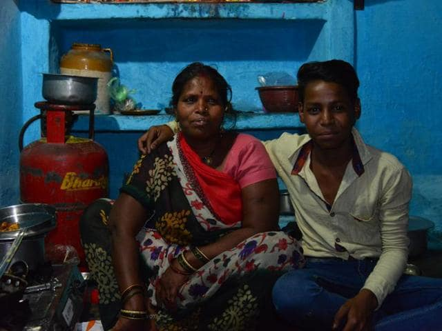 Kaushal, seen here with his mother, says neither he nor his family has talked to anyone about his studies.