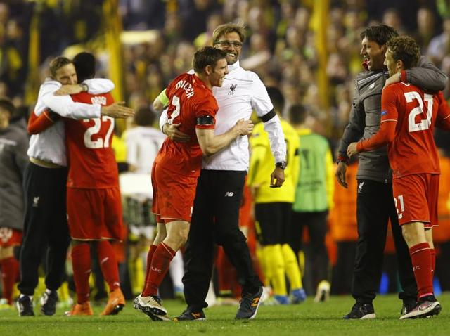 Liverpool's James Milner and manager Juergen Klopp celebrate after winning the Europa League match against Borussia Dortmund.