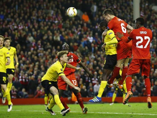 Liverpool's Dejan Lovren scores their fourth goal.