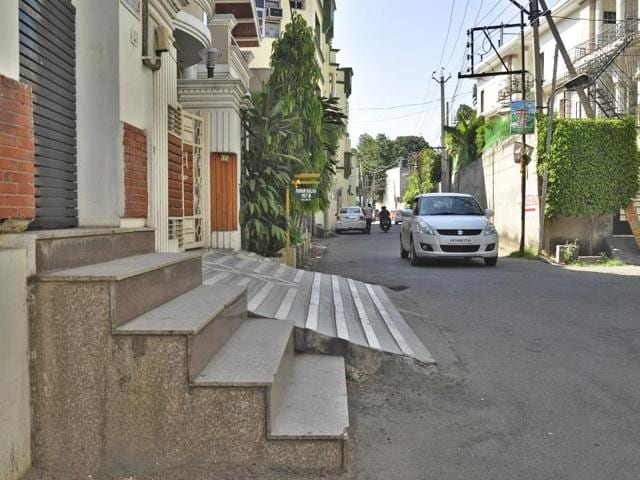 Illegal ramp constructed by encroaching upon a road at Mall Enclave in Ludhiana on Thursday.