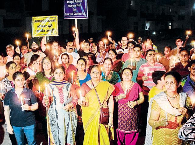 Around 300 residents held a candlelight march on Friday.
