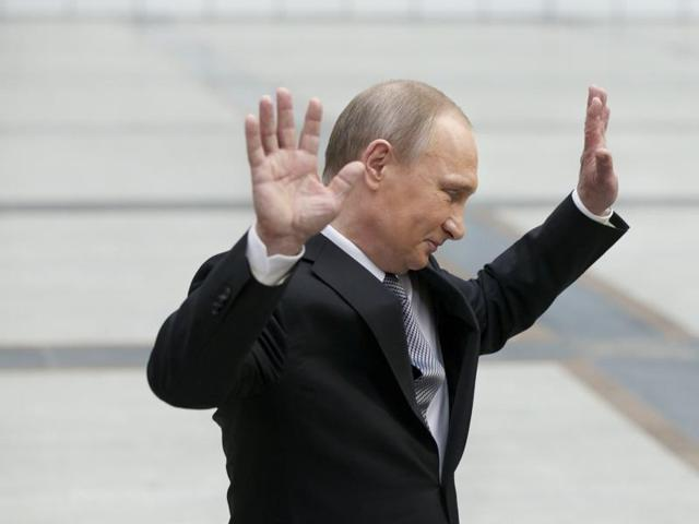 Russian President Vladimir Putin gestures after speaking to the media after his marathon call-in TV show in Moscow.