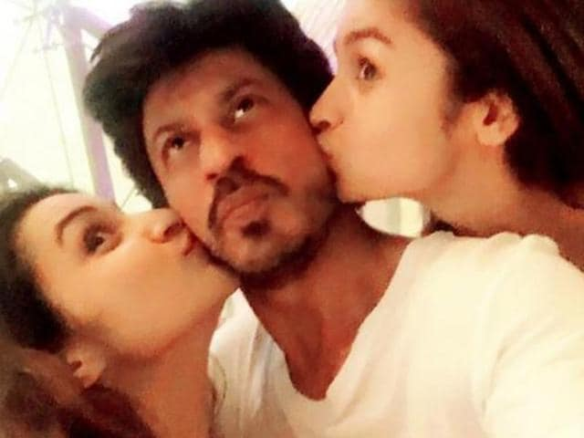 Alia took to her Instagram handle and shared a picture with the 50-year-old actor wherein she and her contemporary Parineeti are seen giving a peck to SRK.