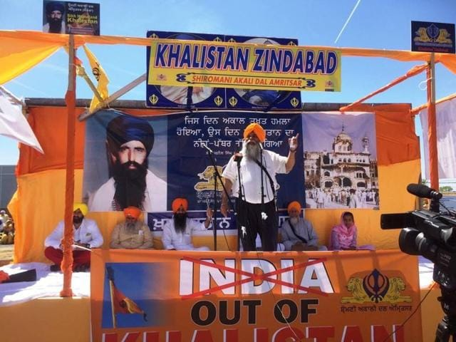 Pakistan's consul general in Toronto, Asghar Ali Golo, with Sukhminder Singh Hansra, a supporter of Khalistan. A poster for a referendum for a Sikh homeland is seen in the background.