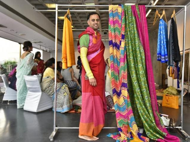 Himanshu Verma, curator of the sari festival, at a sari-styling workshop held in the city, as part of the festival.
