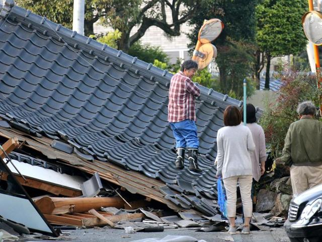 Police officers conduct a search operation at the site of a landslide caused by an earthquake in Minamiaso village, Kumamoto prefecture, Japan, Saturday. The powerful earthquake struck southwestern Japan early Saturday, barely 24 hours after a smaller quake hit the same region.