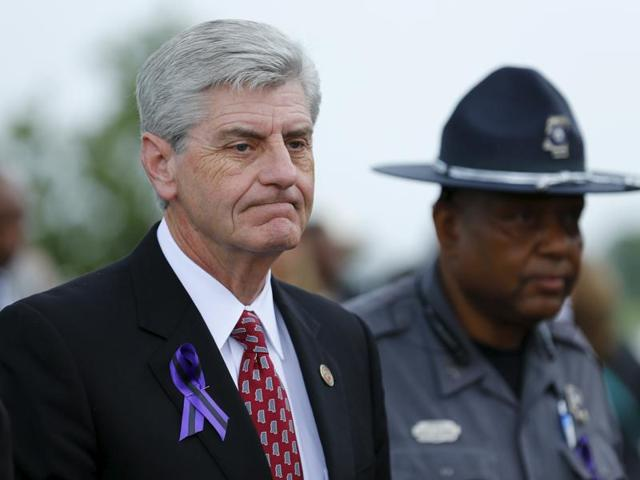 Mississippi, Governor Phil Bryant signed a controversial gun rights bill on Friday that allows churches to create armed security details to defend worshippers against violent intruders.