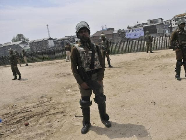 Paramilitary soldiers stand guard outside the office of Jammu and Kashmir Coalition of Civil Society.