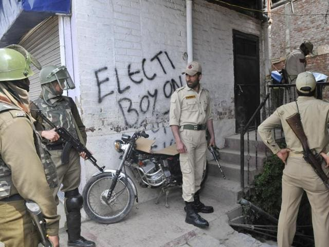 Policemen standing guard outside the office of Jammu and Kashmir Coalition of Civil Society which was scheduled to address media along with the mother of Handwara molestation girl victim.