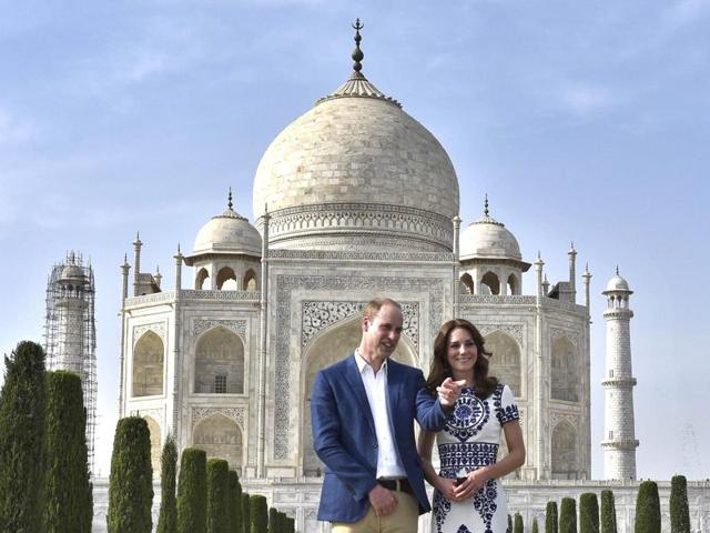 Britain's Prince William, and his wife, Kate, the Duchess of Cambridge during their visit at Taj Mahal in Agra, in April 2016. Scaffoldings can be seen surrounding the front two minarets.