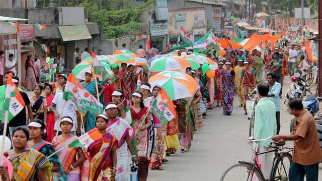 Trinamool Congress (TMC) supporters during an elections campaign rally for the upcoming Assembly polls at Balurghat in South Dinajpur district of West Bengal.