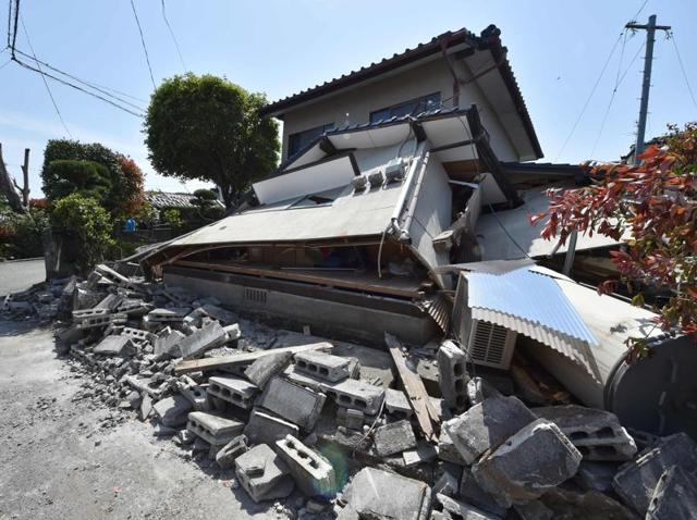 Boulders block a street in the town of Mashiki, Kumamoto prefecture on April 15, 2016.