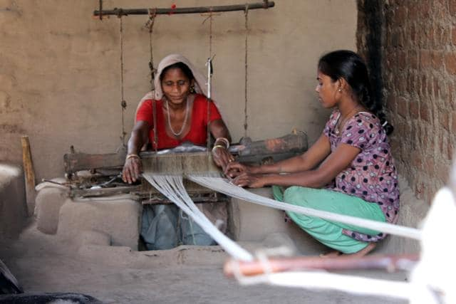 A Kotwal youth works on a foot-charkha at a village in Alirajpur district.