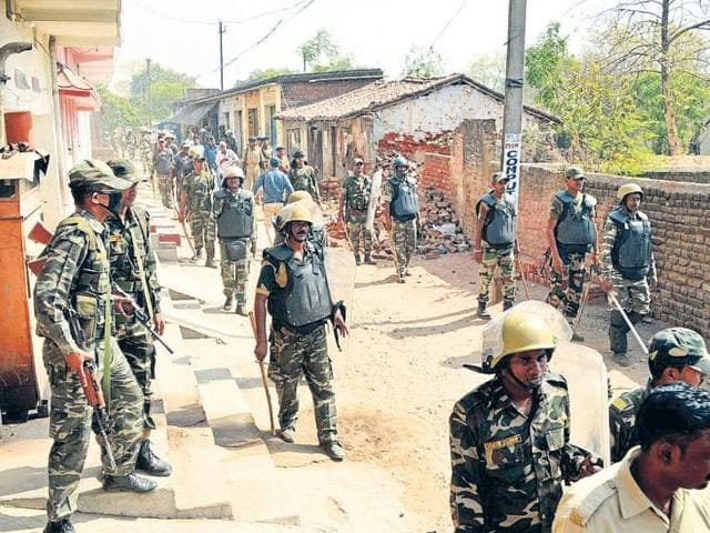 Police personnel patrol affected localities in Bokaro a day after communal clashes on Saturday.