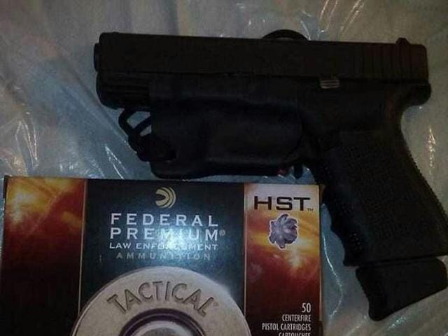 A photo Phillips had uploaded onto his Facebook account of a semi-automatic pistol and a box of ammunition.