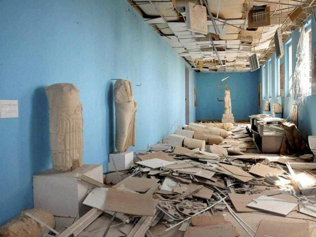 This photo released on Sunday March 27, 2016, by the Syrian official news agency SANA, shows destroyed statues at the damaged Palmyra Museum.