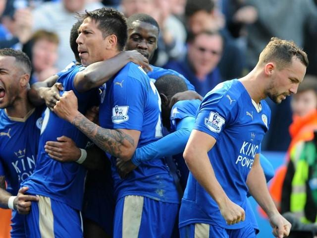 Leicester City's Leonardo Ulloa, centre, celebrates after scoring from the penalty spot.