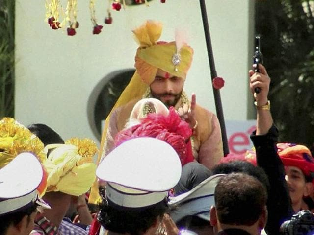 As the marriage procession was moving, apparently one of Ravindra Jadeja's relatives, who was within a few feet of the horse-mounted cricketer, was seen firing in the air from his revolver.