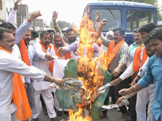 Activists of Shiv Sena (Sher-e-Punjab) burning the Pakistani flag outside the event venue in Amritsar on Saturday.