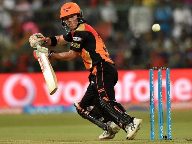 Sunrisers Hyderabad batsman David Warner plays a shot against Royal Challengers Bangalore.