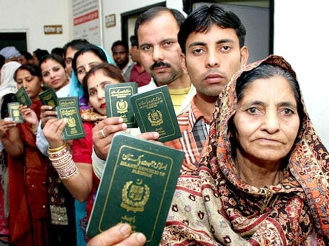 Pakistani Hindus, who seek Indian citizenship, queue up to get their passports verified by the deputy commissioner in Jalandhar.